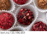 Купить «close up of different candies in paper cups», фото № 33196651, снято 1 февраля 2019 г. (c) Syda Productions / Фотобанк Лори