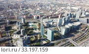 Купить «Aerial view of new residential complex of Diagonal Mar i el Front Maritim del Poblenou in sunny day, Barcelona, Spain», видеоролик № 33197159, снято 5 марта 2019 г. (c) Яков Филимонов / Фотобанк Лори