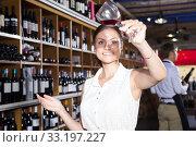 Купить «girl in white dress trying red wine at a wine store», фото № 33197227, снято 29 февраля 2020 г. (c) Татьяна Яцевич / Фотобанк Лори