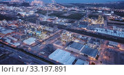 Купить «Aerial view of chemical process plant near Tarragona, Spain», видеоролик № 33197891, снято 17 мая 2019 г. (c) Яков Филимонов / Фотобанк Лори