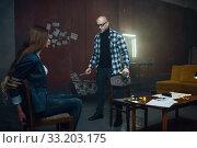 Купить «Maniac kidnapper and his victim with taped mouth», фото № 33203175, снято 13 ноября 2019 г. (c) Tryapitsyn Sergiy / Фотобанк Лори