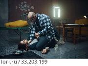 Купить «Maniac kidnapper smothers his scared hostage», фото № 33203199, снято 13 ноября 2019 г. (c) Tryapitsyn Sergiy / Фотобанк Лори