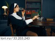 Купить «Sexy nun with cigarete and glass of wine», фото № 33203243, снято 14 ноября 2019 г. (c) Tryapitsyn Sergiy / Фотобанк Лори