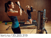 Two women on pilates training in gym, flexibility. Стоковое фото, фотограф Tryapitsyn Sergiy / Фотобанк Лори