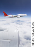 Купить «Planeflying over the clouds», фото № 33204907, снято 4 апреля 2020 г. (c) PantherMedia / Фотобанк Лори