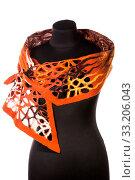 Купить «Женский шарф оранжевого цвета из валяной шерсти на манекене», фото № 33206043, снято 26 января 2020 г. (c) V.Ivantsov / Фотобанк Лори