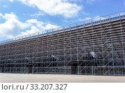 Купить «Steel framework for stadium. Structural steel framework», фото № 33207327, снято 20 июля 2019 г. (c) Евгений Ткачёв / Фотобанк Лори