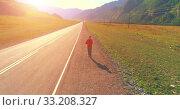 Купить «Low altitude flight in front of sporty man at perfect asphalt road», видеоролик № 33208327, снято 23 февраля 2018 г. (c) Александр Маркин / Фотобанк Лори