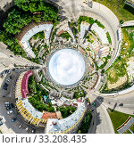Купить «Aerial city view with crossroads and roads, houses, buildings, parks and parking lots. Sunny summer panoramic image», фото № 33208435, снято 29 марта 2020 г. (c) Александр Маркин / Фотобанк Лори