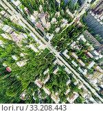 Купить «Aerial city view with crossroads and roads, houses, buildings, parks and parking lots. Sunny summer panoramic image», фото № 33208443, снято 29 марта 2020 г. (c) Александр Маркин / Фотобанк Лори