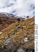 Купить «Severo-Chuy ridge, Uchitel pass, Altai Republic, Russia - September, 16, 2019: A tourist on a path rises uphill», фото № 33208827, снято 16 сентября 2019 г. (c) Вадим Орлов / Фотобанк Лори