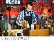 Male worker working on leather for belt in leather. Стоковое фото, фотограф Яков Филимонов / Фотобанк Лори