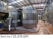 Купить «Modern equpped facilities of wine plant», фото № 33210691, снято 25 февраля 2020 г. (c) Яков Филимонов / Фотобанк Лори