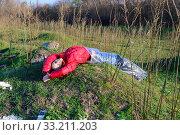 Dead woman lying on landfill. Стоковое фото, фотограф Арестов Андрей Павлович / Фотобанк Лори