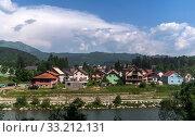 Купить «Rural landscape with mountains and houses in Zabljak Municipality, Montenegro», фото № 33212131, снято 14 июня 2019 г. (c) Володина Ольга / Фотобанк Лори