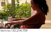 Купить «Focused young woman using smartphone in cafe», видеоролик № 33214759, снято 21 февраля 2020 г. (c) Ekaterina Demidova / Фотобанк Лори