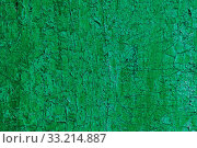 Купить «Texture of a wooden board in green. Cracked from time green paint on a wooden surface», фото № 33214887, снято 9 июля 2020 г. (c) easy Fotostock / Фотобанк Лори
