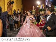 Купить «Oaxaca, Mexico - A quinceañera, or a girl's 15th birthday, is celebrated on the streets of Oaxaca.», фото № 33223875, снято 1 февраля 2020 г. (c) age Fotostock / Фотобанк Лори
