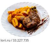 Купить «Appetizing steak in honey marinade with side dish of potatoes an», фото № 33227735, снято 28 февраля 2020 г. (c) Яков Филимонов / Фотобанк Лори