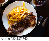 Купить «Tasty veal kebab and french fries served at plate», фото № 33227743, снято 29 февраля 2020 г. (c) Яков Филимонов / Фотобанк Лори