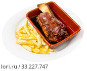 Купить «Oven baked pork knuckle with french fries on plate», фото № 33227747, снято 4 апреля 2020 г. (c) Яков Филимонов / Фотобанк Лори