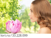 Купить «beautiful woman with pink lotus flower», фото № 33228099, снято 10 октября 2010 г. (c) Syda Productions / Фотобанк Лори