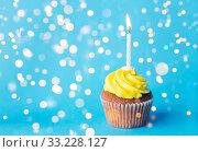 Купить «birthday cupcake with one burning candle», фото № 33228127, снято 30 июня 2016 г. (c) Syda Productions / Фотобанк Лори