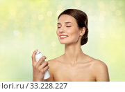 Купить «beautiful young woman with facial spray or mist», фото № 33228227, снято 30 ноября 2019 г. (c) Syda Productions / Фотобанк Лори