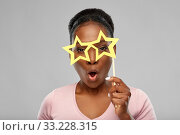 Купить «african american woman with star shaped glasses», фото № 33228315, снято 26 января 2020 г. (c) Syda Productions / Фотобанк Лори