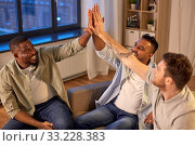 Купить «happy male friends making high five at home», фото № 33228383, снято 28 декабря 2019 г. (c) Syda Productions / Фотобанк Лори