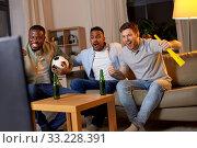 Купить «friends with ball and vuvuzela watching soccer», фото № 33228391, снято 28 декабря 2019 г. (c) Syda Productions / Фотобанк Лори