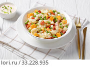 Купить «cauliflower salad in a white bowl, close-up», фото № 33228935, снято 28 ноября 2019 г. (c) Oksana Zh / Фотобанк Лори