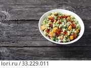 Купить «elbow pasta salad with green peas, closeup», фото № 33229011, снято 28 ноября 2019 г. (c) Oksana Zh / Фотобанк Лори