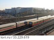 Berlin, Germany, ICE and S-Bahn on free line at the station Suedkreuz. Редакционное фото, агентство Caro Photoagency / Фотобанк Лори