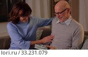 Купить «happy senior couple with gift box at home», видеоролик № 33231079, снято 4 января 2020 г. (c) Syda Productions / Фотобанк Лори