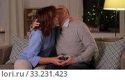 Купить «happy senior couple with gift box at home», видеоролик № 33231423, снято 4 января 2020 г. (c) Syda Productions / Фотобанк Лори