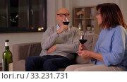 Купить «happy senior couple drinking red wine at home», видеоролик № 33231731, снято 20 января 2020 г. (c) Syda Productions / Фотобанк Лори