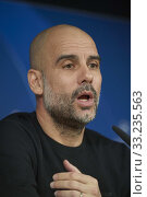 Pep Guardiola during a press conference ahead of their UEFA Champions League round of 16 first leg match against Real Madrid at Santiago Bernabeu Stadium on February 25, 2020 in Madrid, Spain. Редакционное фото, фотограф Manuel Cedron / age Fotostock / Фотобанк Лори