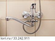 Bathroom water tap, faucet with shower in one. Close up view. Стоковое фото, фотограф Кекяляйнен Андрей / Фотобанк Лори