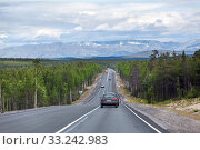 Long highway stretches away to mountains on horizon. Cars driving on asphalt road the Kola. It is way to the Murmansk city on north of Russia. Стоковое фото, фотограф Кекяляйнен Андрей / Фотобанк Лори