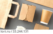 Купить «disposable paper takeaway food packing stuff», видеоролик № 33244131, снято 8 июля 2020 г. (c) Syda Productions / Фотобанк Лори