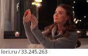 Купить «happy young woman with sparklers at home», видеоролик № 33245263, снято 21 января 2020 г. (c) Syda Productions / Фотобанк Лори