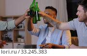 Купить «male friends drinking beer and watching tv at home», видеоролик № 33245383, снято 12 января 2020 г. (c) Syda Productions / Фотобанк Лори