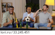 Купить «friends with ball and vuvuzela watching soccer», видеоролик № 33245451, снято 12 января 2020 г. (c) Syda Productions / Фотобанк Лори
