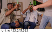 Купить «happy male friends drinking beer at home at night», видеоролик № 33245583, снято 12 января 2020 г. (c) Syda Productions / Фотобанк Лори