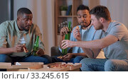 Купить «male friends drinking beer and watching tv at home», видеоролик № 33245615, снято 13 января 2020 г. (c) Syda Productions / Фотобанк Лори