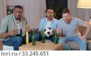 Купить «friends with ball and vuvuzela watching soccer», видеоролик № 33245651, снято 13 января 2020 г. (c) Syda Productions / Фотобанк Лори