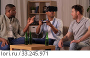 Купить «male friends playing video games at home at night», видеоролик № 33245971, снято 13 января 2020 г. (c) Syda Productions / Фотобанк Лори