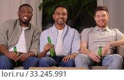 Купить «happy smiling male friends with beer at home», видеоролик № 33245991, снято 13 января 2020 г. (c) Syda Productions / Фотобанк Лори