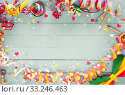 Colorful party frame with streamers and confetti. Стоковое фото, фотограф Daniel Reiter / PantherMedia / Фотобанк Лори